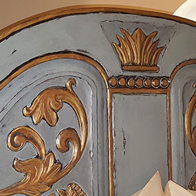 Headboard detail, painted to compliment bedding. Home has a French motif design.  Paradise Valley, AZ