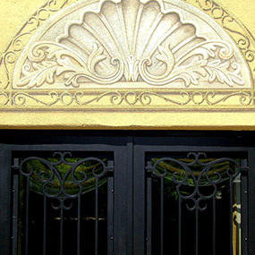 tromp l' oeil detail over wrought iron doors. Painted on outdoor stucco wall. Silverleaf, Scottsdale, AZ